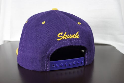 Image of Skunk Snap Back | Purple and Gold