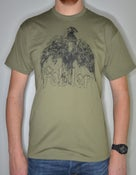 "Image of ""dove"" t-shirt black on olive (price = PPD NL) Get in touch for international shipping."