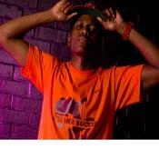 Image of Pure Flowz Apparel Male- Orange Tee - Brown Design: