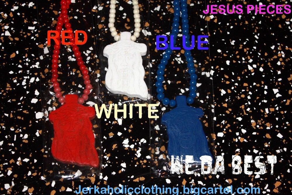 Image of red jesus piece