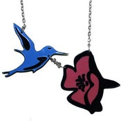 Image of Ltd. Edition Hummingbird and Flower Necklace made from recycled vinyl records.