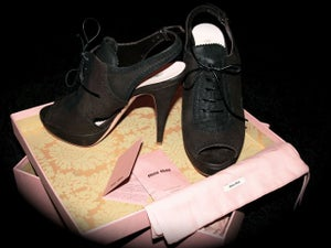 Image of MIU MIU dark brown leather cut-out lace-up pumps