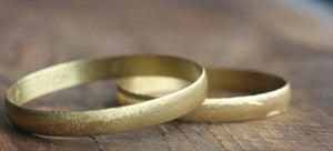Image of round flat brass bracelet