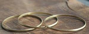 Image of 3 Skinny round brass bracelet