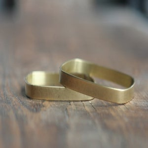 Image of 3 small Square brass bracelets