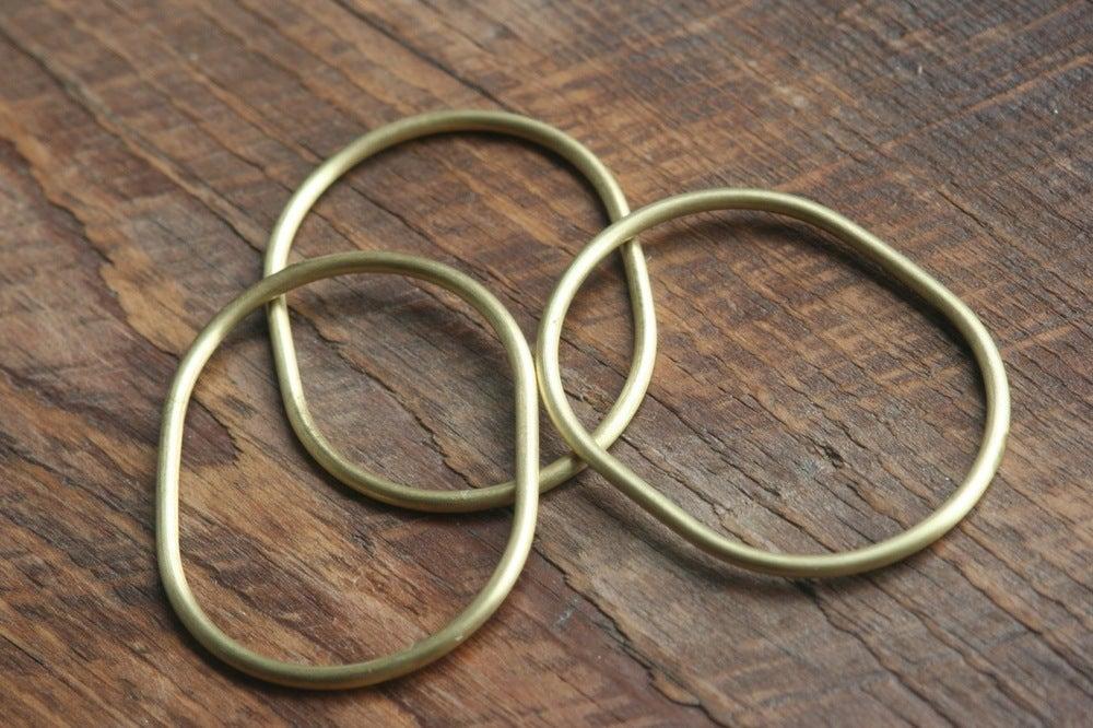 Image of 3 small oval brass bracelets
