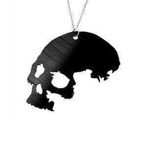 Image of Skull Necklace/Earrings made from a recycled vinyl record.