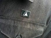Image of Human Pyramids Logo Lapel.