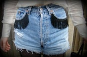 Image of Vintage Levis shorts with Fringed detail.