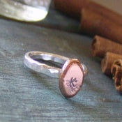 Image of silver and copper pebble hand stamped initial stacking ring