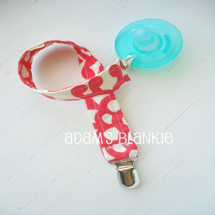 how to keep a pacifier from falling out