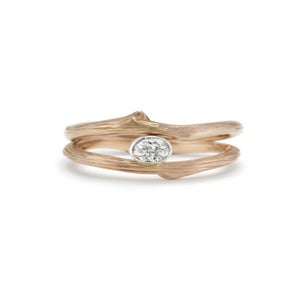 Image of custom vineyard engagement and wedding rings