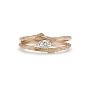 Image of custom vineyard engagement and wedding rings
