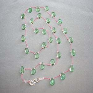 Image of Green Glass on Pink Silk Cord