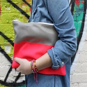 Image of neon color block clutch