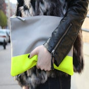 Image of neon stripe clutch