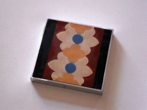 Image of Double rust flower coaster