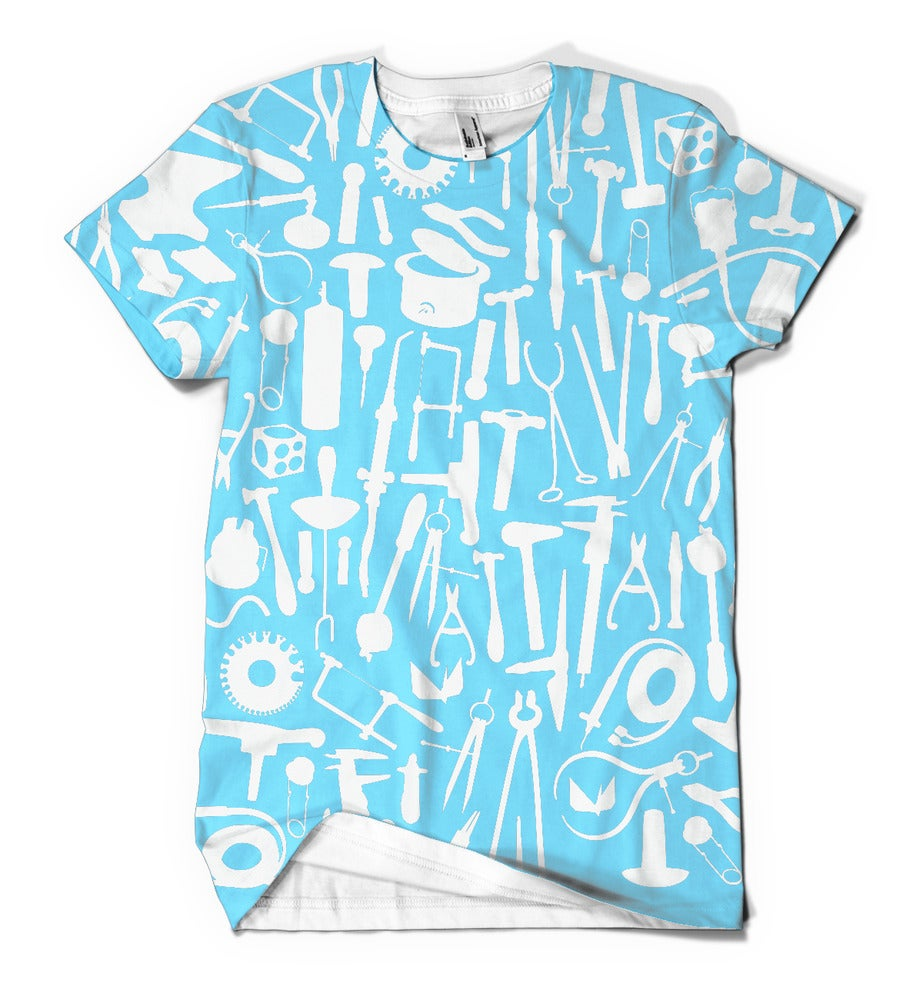 Image of Metals tools: white tools on baby blue background on white shirt