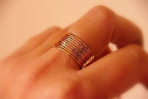 Image of 10 thin slender hammered 14k gold filled unique rustic stackable rings