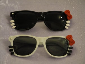 Image of Hello Kitty Nerd Sunglasses with bow and whiskers (Dark Lenses)