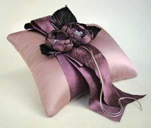 Image of Tailored Garden Ring Pillow in Plums