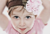 Image of Cotton Candy Carnival Headband with Light Pink & Army Green Pinwheels. Fun. Sassy. Sweet.