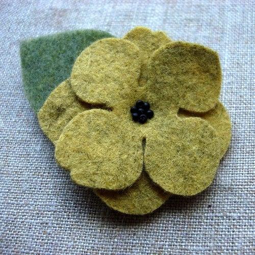Image of medium beaded flower clip // warm colors