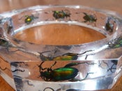 Image of Octagon resin bracelet featuring 'Fergus the Frog beetle '- green