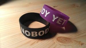 """Image of """"I AM NOBODY YET"""" Wristbands"""