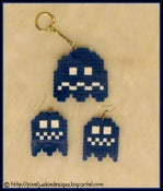 Image of pacman ghost keychain and earrings