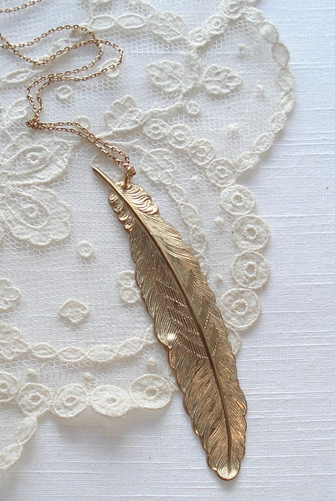 Image of Gold feather pendant