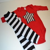 Image of Red Onesie w/ White & Black Striped Star & Matching Leg Warmers
