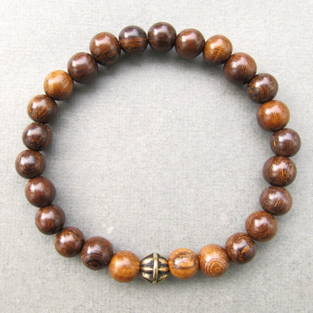 Image of Brown robles beaded stretch bracelet with antique gold bead