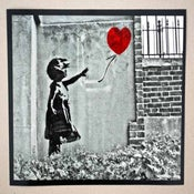 """Image of Banksy - Girl With Balloon - Black & White 10"""" x 8"""" photo, with hand coloured red balloon"""