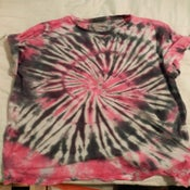 Image of pink and black swirl tee