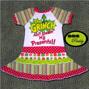Image of **SOLD OUT** The Grinch Ain't Stealin' My Presents Double Ruffle Dress - Size 3/4