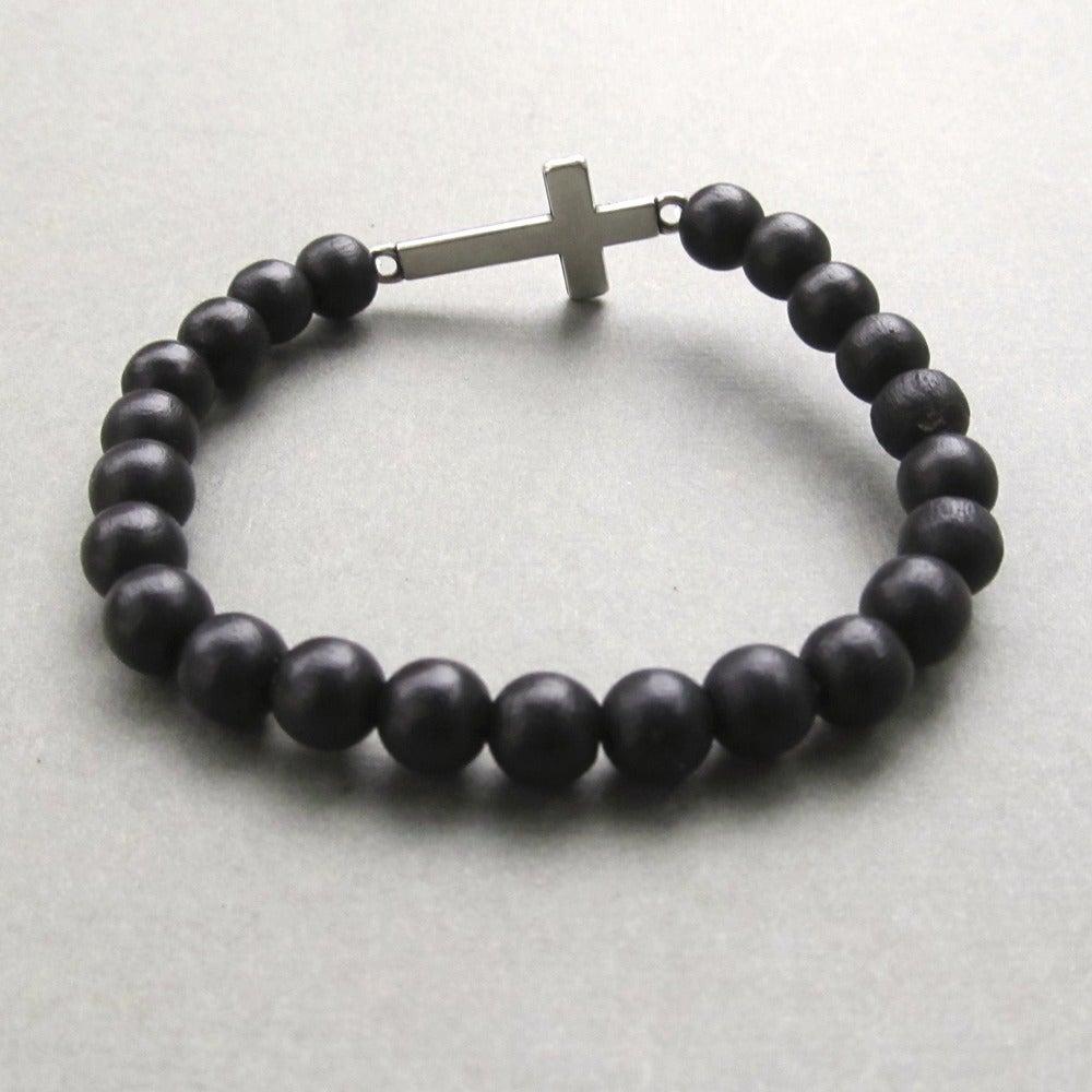 Image of Black beaded stretch bracelet with sideways cross