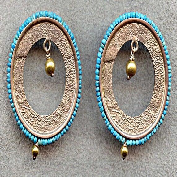 Of øreringe i sterling sølv med turkis fra vestasien og 18k guld