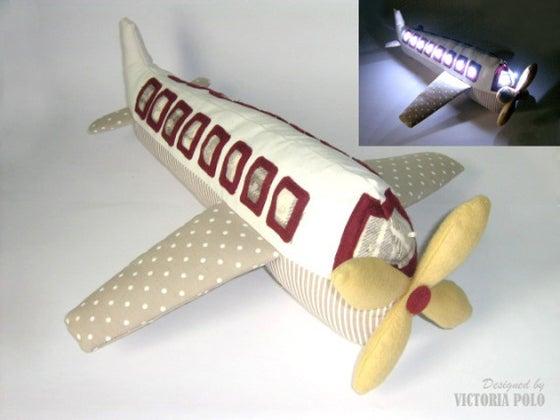 Image of Avión con luces quitamiedos. Patrones de costura (PDF)
