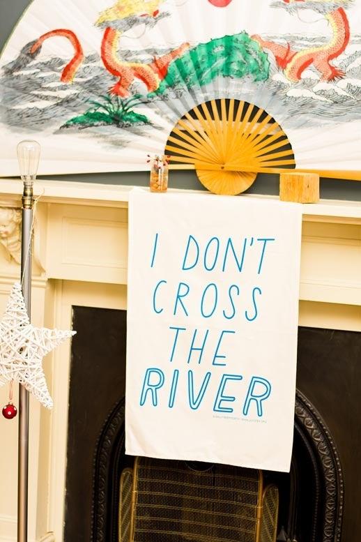Image of I don't cross the river Tea Towel