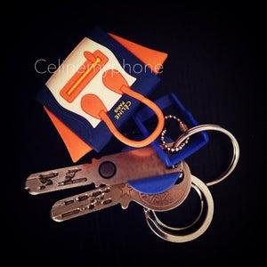 Image of WITH LOGO - Céline my phone Headphone Plug - orange/blue/white