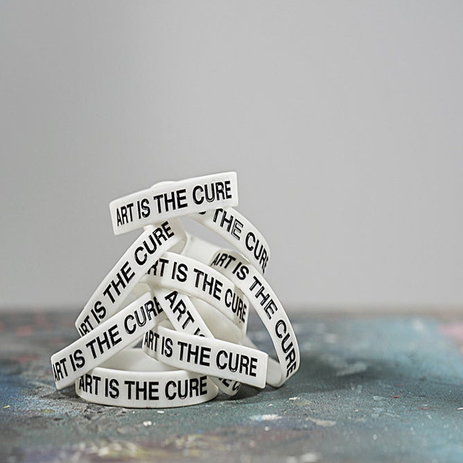 Image of Art Is The Cure Glow in the dark bracelet